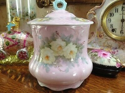 Hand painted porcelain pink cookie jar with roses