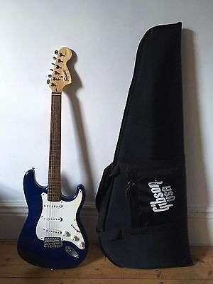 Electric Guitar - Squier Strat by Fender (comes with case)