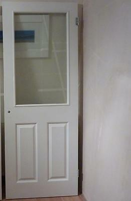 White wood and glass internal door
