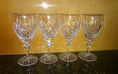 Four matching crystal wine glasses