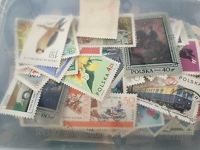 off paper selection of world stamps, many poland and romania in box