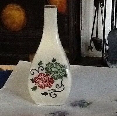 Japanese Porcelain Vase With A Red, Green And Blue Floral Design