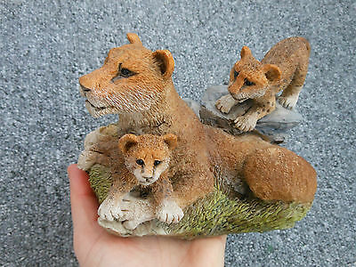 Lioness with two cubs resin ornament