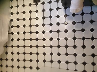 28 sheets of black and white mosiac floor tiles