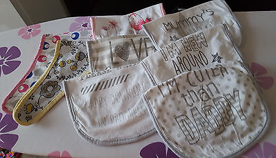 A pack of 8 baby girls bibs