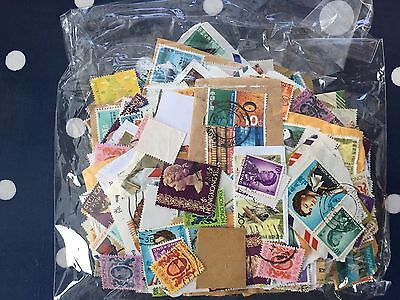 Hong Kong stamp hoard on and off paper in bag nice lot
