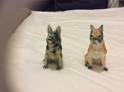 two collectable porcelain  ornament dog figures.