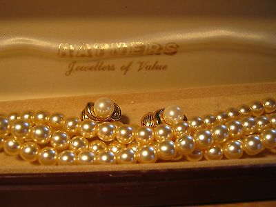 Double string of freshwater pearls and clip on earings in presentation box