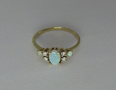 14K yellow gold natural opal and diamond  size 6 ring