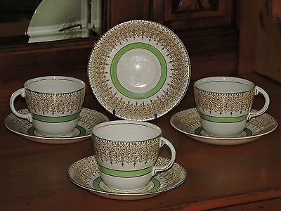 Vintage  BARRATTS of STAFFORDSHIRE ENGLAND  3 cupand 5 saucers.