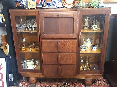 vintage sideboard with glass dlay and cocktail cabinet