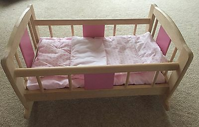 Pintoy Wooden Pink Rocking Toy Cot