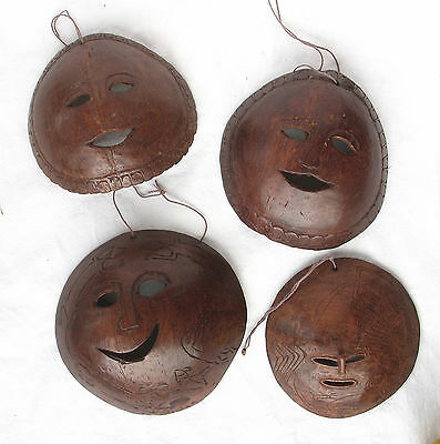 4 pc TIMOR COCONUT SHELL AMULETS / CHARM / MASK - ARTIFACT - late 20th C