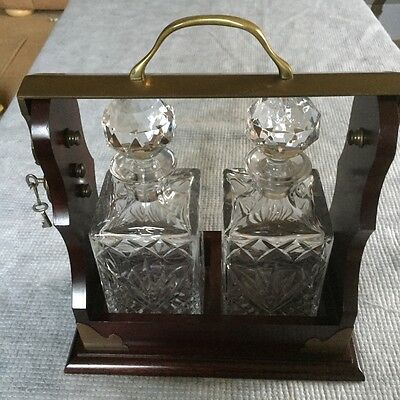 Tantalus with 2 crystal decanters and key