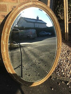 large vintage oval mirror with beveled glass