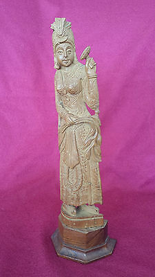 An asia wood carved statue