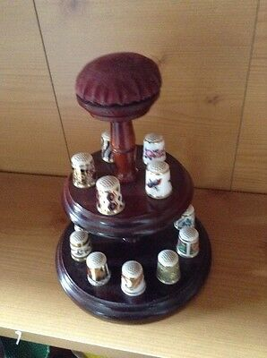 A Collection Of 15 Royal Crown Derby Thimbles On Display Stand With Pin Cushion