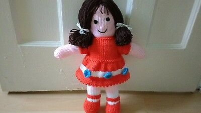 Pretty hand knitted toy doll
