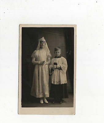 Photograph Of Boy And Girls First Communion