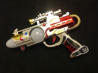 1950's FLASH-GORDON TYPE SPACE-GUN  FULLY LIGHTS UP SILVER RED & GOLD IN COLOUR.