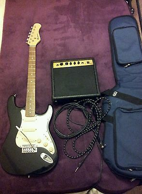 Electric guitar, new case & amp