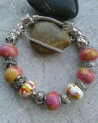 European silver charm bracelet with muti pink beads