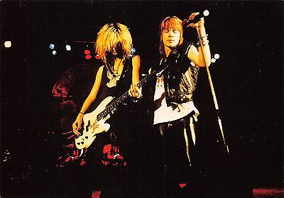 Guns N' Roses Axl Rose and bassist on stage, concert