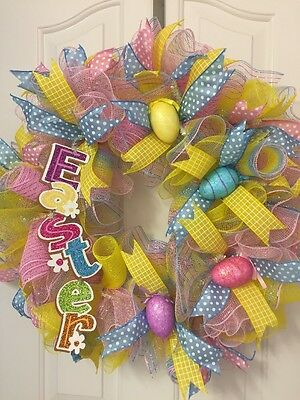 "26"" Easter Deco Mesh Wreath. Pastel Mesh W/ Polka Dot Ribbon, And Easter Eggs."