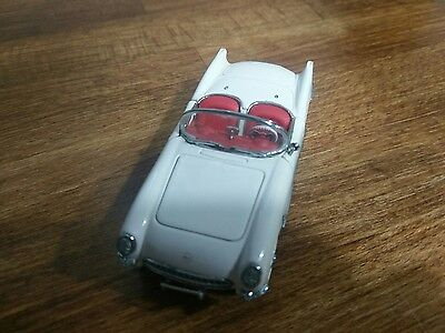A Franklin mint scale model car of a 1953 Chevrolet Corvette convertible, boxed