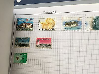 Asia incl North Borneo collection of stamps in album on pages from  estate