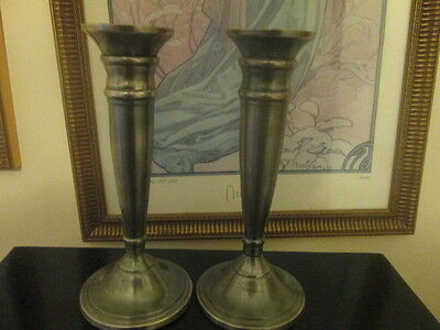pair of candle sticks in stainless steel