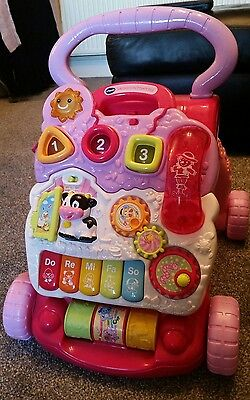 excellent condition pink vtech baby walker with box