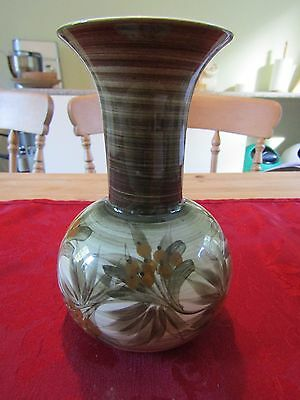 Jersey pottery bulbus decorated vase . 6 inches tall
