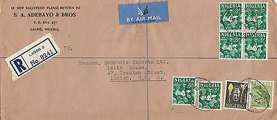 C 1713 Nigeria  Registered 1964 airmail cover UK; 8 stamps; block of 4; 3/- rate