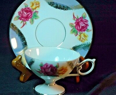 Napco handpainted Roses Pedestal Cup and Saucer