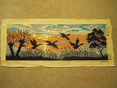 Lovely hand-stitched completed wool tapestry geese flying at sunset