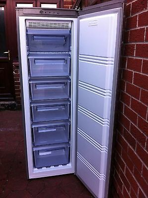 Frost Free Silver/grey Logik Upwright Freezer In Good Working Condition.