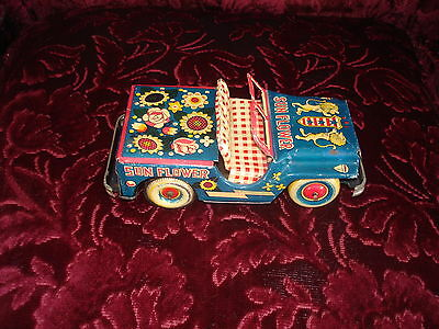 rare japanese tin or marx friction sun flower jeep toy with lion crest