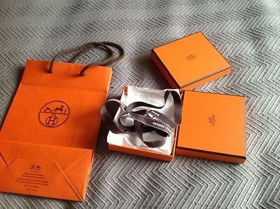 2  small Hermes boxes with paper, ribbon and a bag