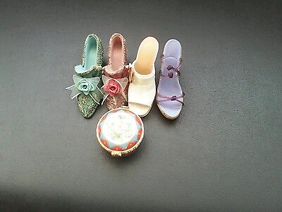Selection of ornamental shoes and a trinket box