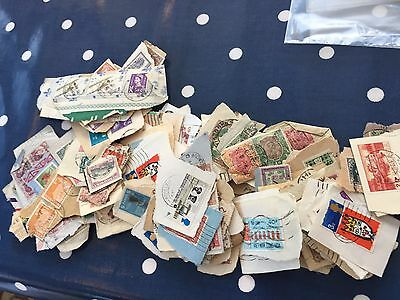World interesting hoard of stamps on paper wide range of periods and countries