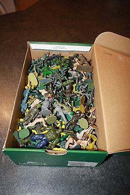 a large vintage boxfull of toy soldiers various types job lot
