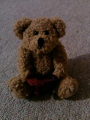 Small teddy with heart