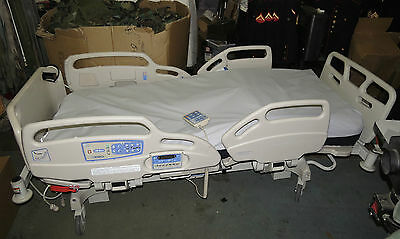 Hill-Rom Care Assist ES Hospital Bed includes  Mattress Hill Rom