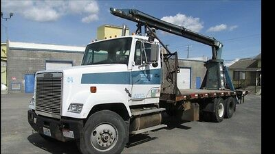 freightliner semi with flatbed and jiffy jib boom crane