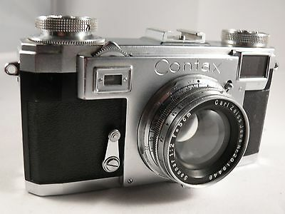 Vintage Ziess Ikon Contax model 2A 35 mm Camera with 3 lenses with cases.