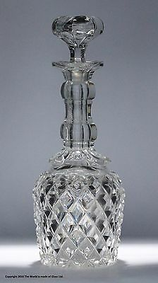 Victorian heavily cut glass decanter, petal stopper