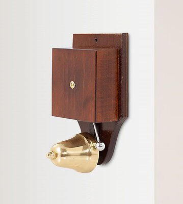 Wired Wall Mounted Retro Striker Doorbell, brass bell on a dark stained wood cas