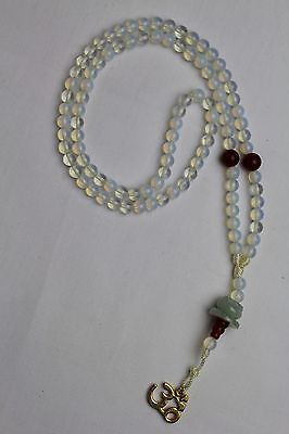 Clear and Amber with OM &  Jade Mala