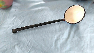 Porcelain covered metal ladle black and white vintage antique style.